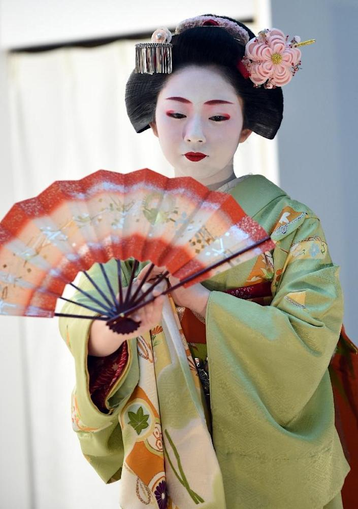 Geishas are skilled in Japanese arts such as dance, the lute and three-stringed shamisen (AFP Photo/Toshifumi Kitamura)