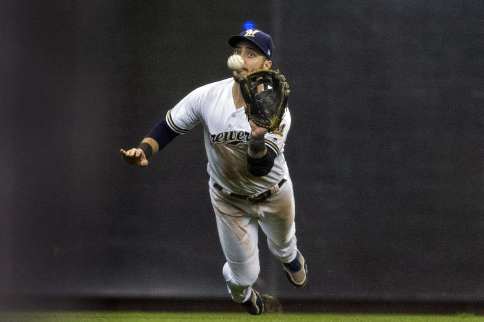FILE - In this April 22, 2017, file photo, Milwaukee Brewers' Ryan Braun makes a diving catch on St. Louis Cardinals' Kolten Wong's fly ball but made a throwing error allowing a run to score during the fourth inning of a baseball game in Milwaukee. Braun, the Brewers' home run leader whose production was slowed by injuries during the second half of his 14-year career, announced his retirement on Tuesday, Sept. 14, 2021. Braun hasn't played all season and said during spring training that he was leaning toward retirement. (AP Photo/Tom Lynn, File)