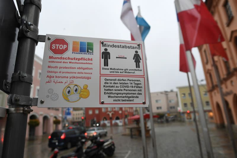 A sign reminding people to wear a mask is seen prior to an ordered lock-down due to the further spreading of the coronavirus disease (COVID-19) in Pfarrkirchen