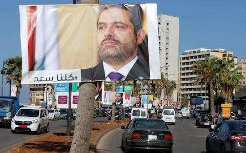 Posters in solidarity with Mr Hariri have gone up in parts of Lebanon - Credit: REUTERS/Mohamed Azakir