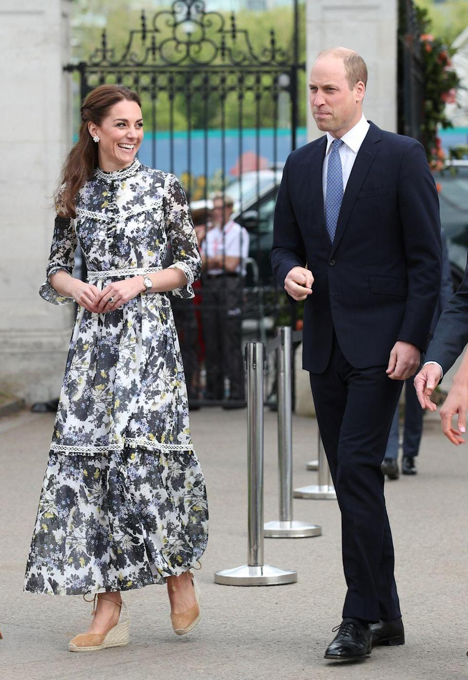"""<p>To show the Queen a garden she'd designed at the Chelsea Flower Show,<a href=""""https://www.townandcountrymag.com/style/fashion-trends/a27530823/kate-middleton-erdem-dress-chelsea-flower-show-2019/"""" rel=""""nofollow noopener"""" target=""""_blank"""" data-ylk=""""slk:the Duchess went for a high-necked, floral Erdem dress"""" class=""""link rapid-noclick-resp""""> the Duchess went for a high-necked, floral Erdem dress</a>, along with a pair of summery espadrilles.</p>"""