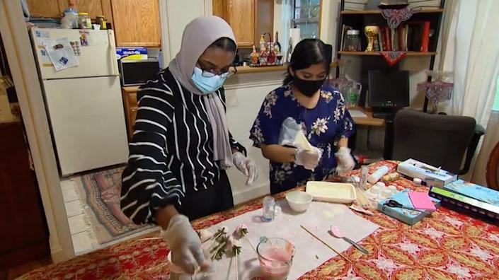 Virginia high school seniors Farah Bahr and Sithiya Reshmee learned how to make candy to sell during the pandemic. / Credit: CBS News