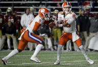 Clemson quarterback Trevor Lawrence, right, hands off to running back Travis Etienne during the first half of an NCAA college football game against Boston College, Saturday, Nov. 10, 2018, in Boston. (AP Photo/Elise Amendola)
