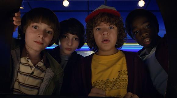 Stranger Things 2 characters Will, Mike, Dustin, and Lucas looking into the camera.