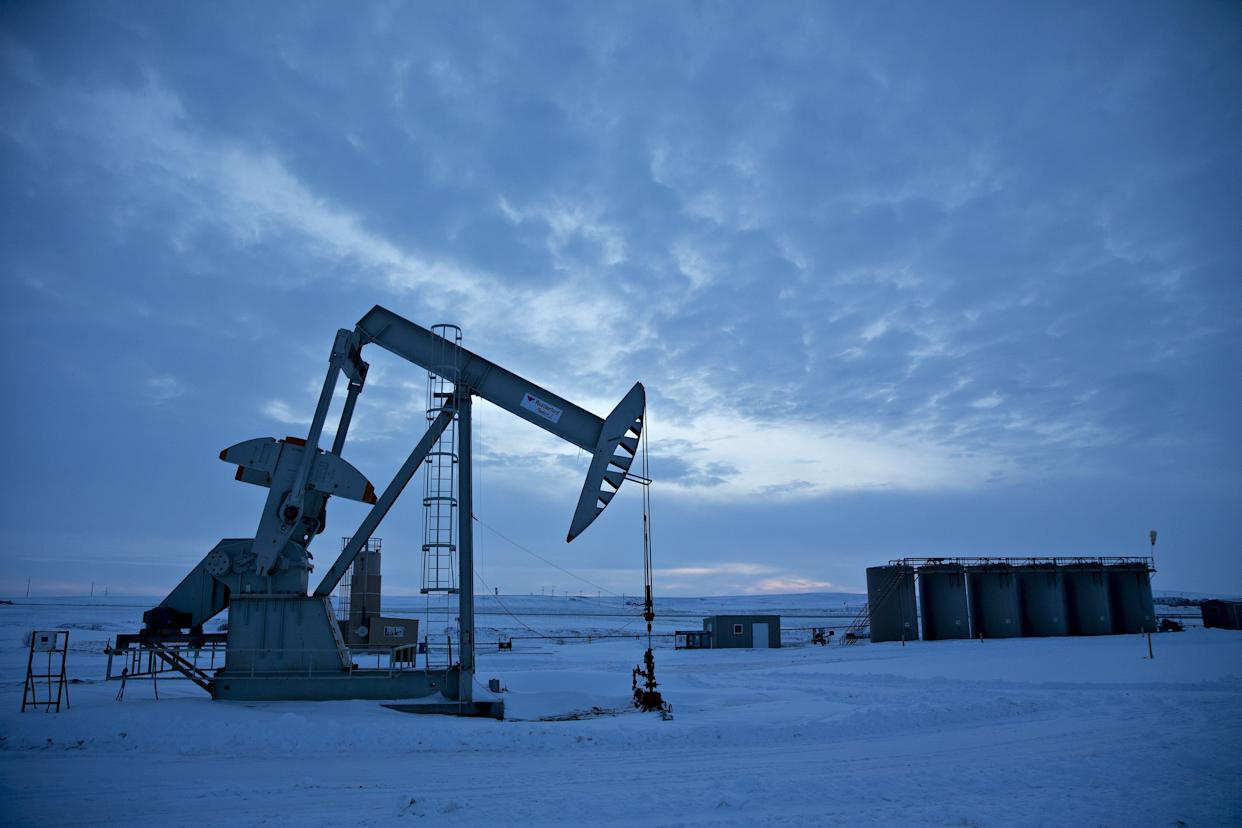 A pumpjack operates above an oil well in the Bakken Formation outside Williston, North Dakota, U.S., on Friday, March 9, 2018 (Photo: Bloomberg via Getty Images)