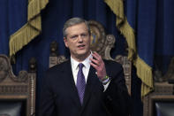 FILE - In this Tuesday, Jan. 21, 2020 file photo, Massachusetts Gov. Charlie Baker delivers his state of the state address in the House Chamber at the Statehouse in Boston. While governors across the country are ending all or most of their coronavirus restrictions, many of them are keeping their pandemic emergency orders in place. Those orders allow them to restrict public gatherings and businesses, mandate masks, sidestep normal purchasing rules, tap into federal money and deploy National Guard troops to administer vaccines. (AP Photo/Steven Senne, File)
