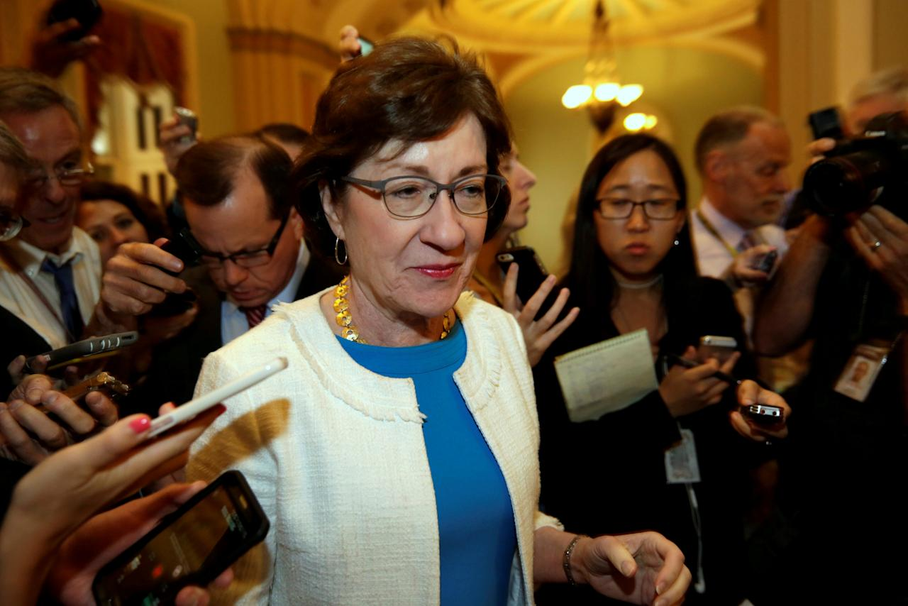 FILE PHOTO: Senator Susan Collins (R-ME) talks to reporters as she arrives for a Senate healthcare vote on Capitol Hill in Washington, U.S., July 27, 2017. REUTERS/Yuri Gripas/File Photo
