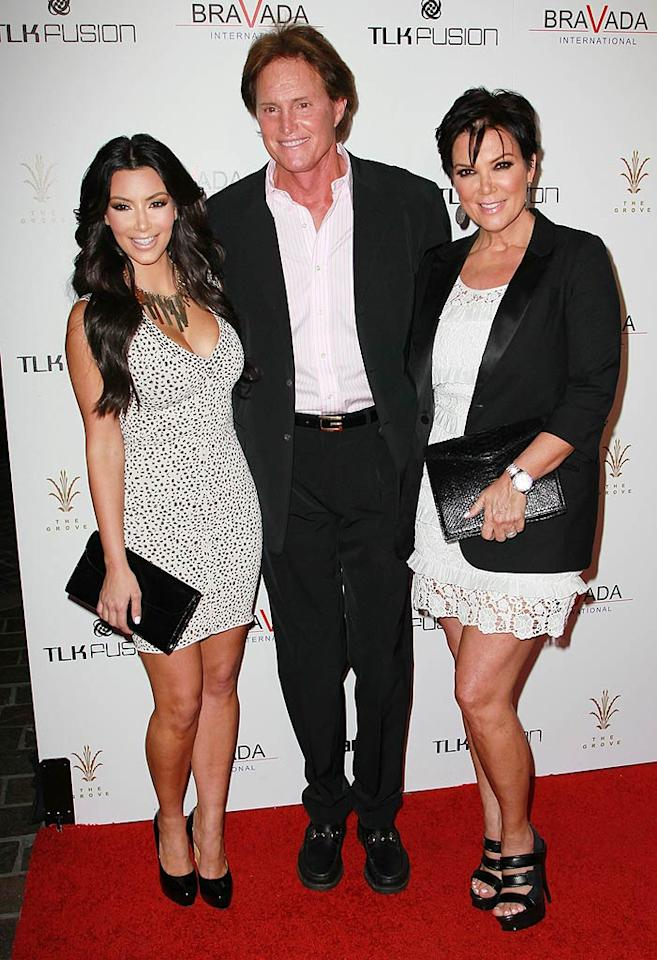 "Kim Kardashian, her stepdad Bruce Jenner, and her mom Kris hit the red carpet for the Bravada International launch party held at the Whisper Lounge in Los Angeles. David Livingston/<a href=""http://www.gettyimages.com/"" target=""new"">GettyImages.com</a> - April 7, 2010"