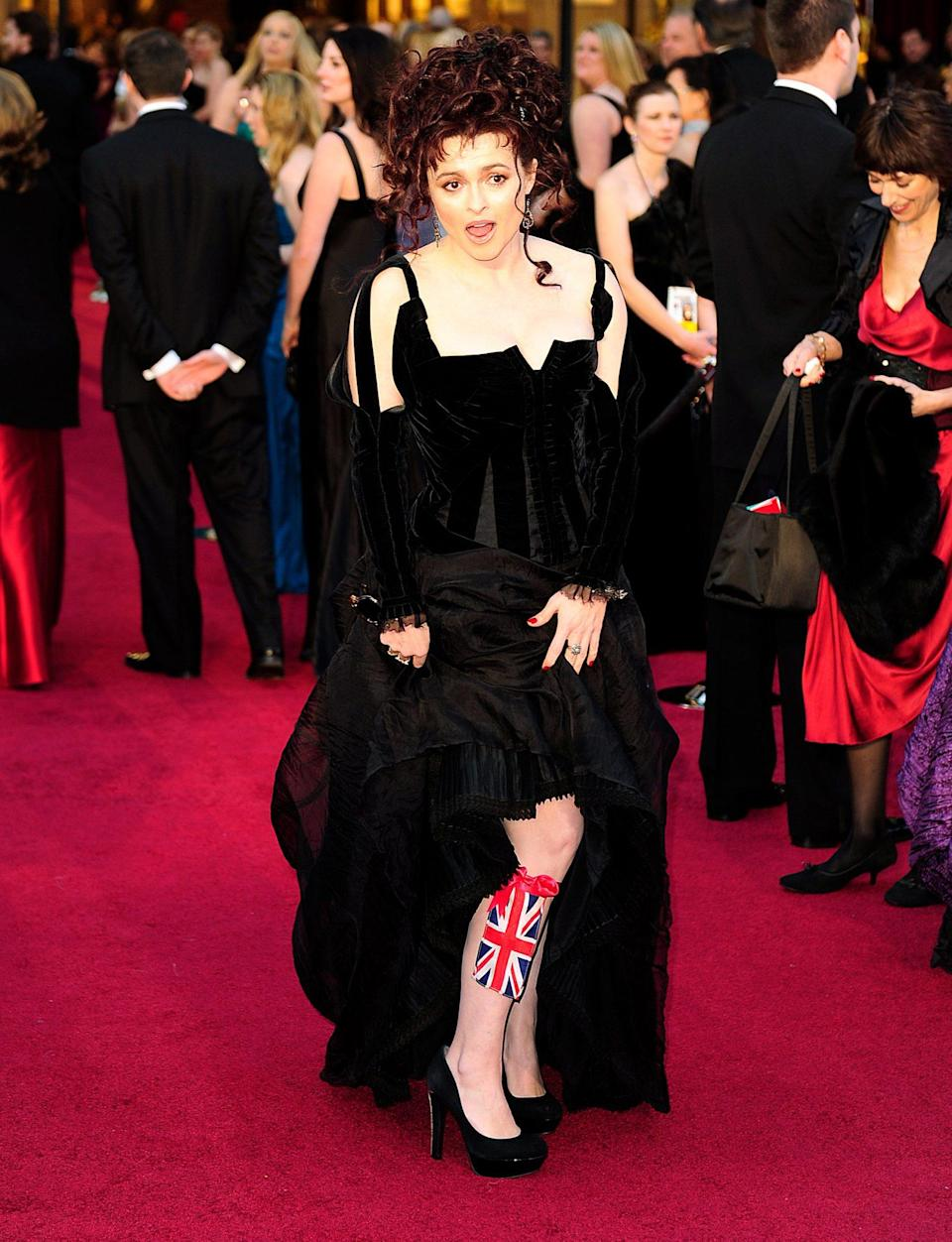 <p>Helena Bonham Carter flashed some leg — and a Union Jack garter — on the red carpet. </p>