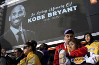Fans mourn the loss of Kobe Bryant in front of La Live across from Staples Center, home of the Los Angeles Lakers in Los Angeles on Sunday, Jan. 26, 2020. Bryant, the 18-time NBA All-Star who won five championships and became one of the greatest basketball players of his generation during a 20-year career with the Los Angeles Lakers, died in a helicopter crash Sunday. (Keith Birmingham/The Orange County Register via AP)