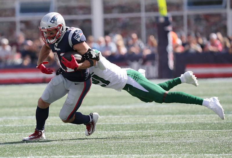 The Patriots' Julian Edelman scored a TD against the Jets on Sunday but also left with a chest injury. (Getty Images)