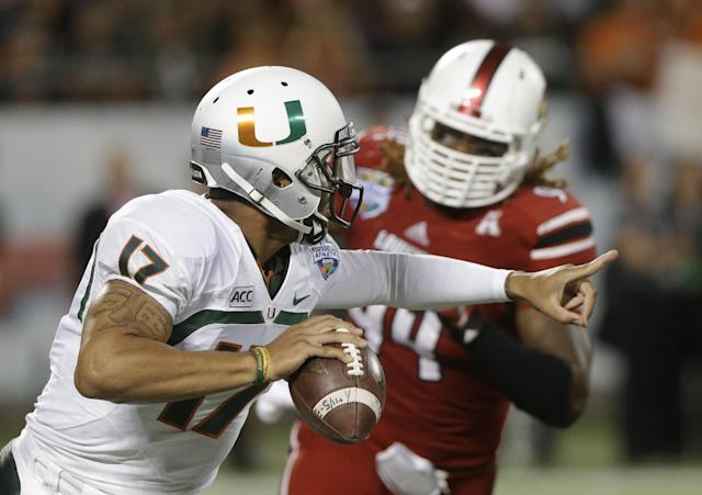 Miami quarterback Stephen Morris (17) scrambles away from Louisville defensive end Lorenzo Mauldin during the first half of the Russell Athletic Bowl NCAA college football game in Orlando, Fla., Saturday, Dec. 28, 2013. (AP Photo/John Raoux)