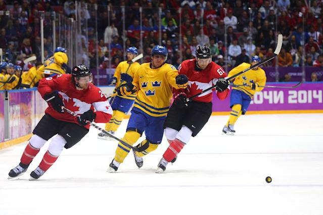 SOCHI, RUSSIA - FEBRUARY 23: Rick Nash #61 of Canada skates against Alexander Steen #20 of Sweden during the Men's Ice Hockey Gold Medal match on Day 16 of the 2014 Sochi Winter Olympics at Bolshoy Ice Dome on February 23, 2014 in Sochi, Russia. (Photo by Martin Rose/Getty Images)