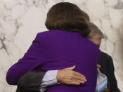 Sen. Lindsey Graham, R-S.C., hugs Sen. Dianne Feinstein, D-Calif., following the fourth day of a confirmation hearing for Supreme Court nominee Amy Coney Barrett, before the Senate Judiciary Committee, Thursday, Oct. 15, 2020, on Capitol Hill in Washington. (Jonathan Ernst/Pool via AP)
