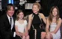 "<p>Kidman and Urban's daughters, Sunday and Faith, <a href=""https://people.com/parents/golden-globes-2021-nicole-kidman-keith-urban-rare-daughters-faith-sunday/"" rel=""nofollow noopener"" target=""_blank"" data-ylk=""slk:made a rare appearance alongside their parents"" class=""link rapid-noclick-resp"">made a rare appearance alongside their parents</a>. </p>"