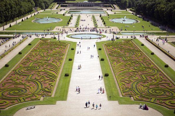 """<p>Nicolas Fouquet, the superintendent of finances of Louis XIV, called upon three of the country's most renowned artisans to develop a château and garden the embodied French grandeur. Together, architect Louis Le Vau, landscape architect André le Nôtre, and painter-decorator Charles Le Brun worked to build the architectural jewel of the 17th-century, marking the beginning of the """"Louis XIV style"""" where structures and gardens were built on a visual axis. </p><p>In particular, the formal gardens feature symmetrical, strong lines with flowers and boxwoods laid out in arabesques. There's also a number of surprises throughout the property including a Grand Canal hidden from the château's view. </p>"""