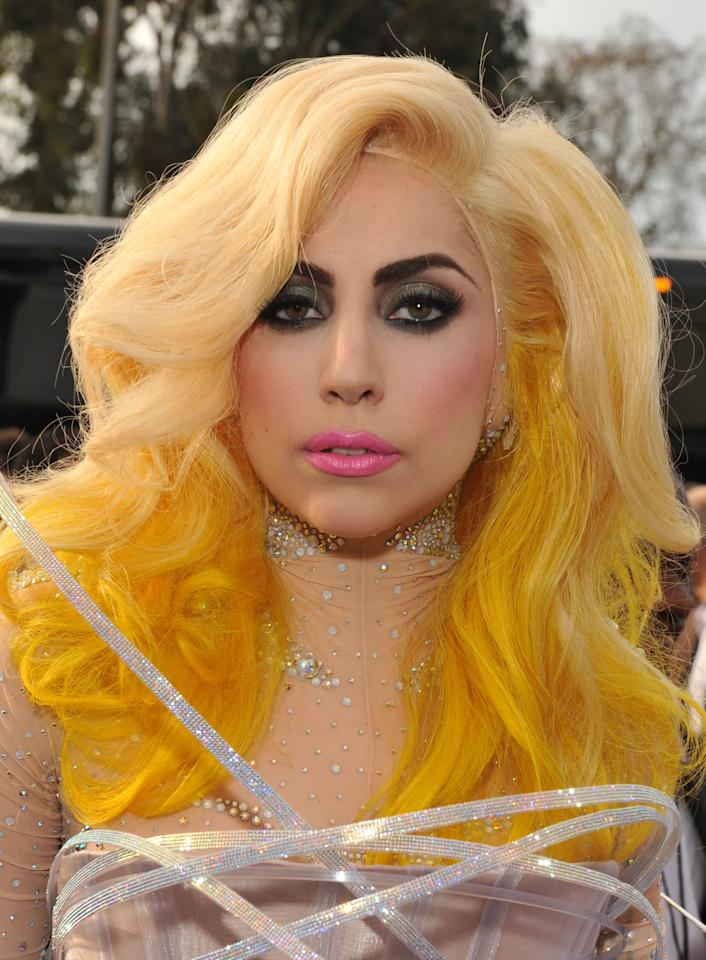 "<p>Back when <a class=""sugar-inline-link ga-track"" title=""Latest photos and news for Lady Gaga"" href=""https://www.popsugar.co.uk/Lady-Gaga"" target=""_blank"" data-ga-category=""Related"" data-ga-label=""https://www.popsugar.co.uk/Lady-Gaga"" data-ga-action=""&lt;-related-&gt; Links"">Lady Gaga</a>'s outfits were larger than life, she wore this voluminous yellow wig and heavy makeup at the Grammys.</p>"