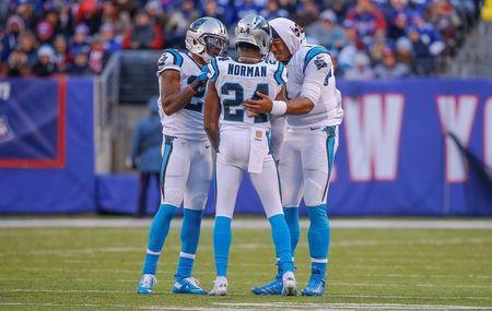 Dec 20, 2015; East Rutherford, NJ, USA; Carolina Panthers quarterback Cam Newton (right) and free safety Kurt Coleman (left) try to calm down cornerback Josh Norman (24) after unsportsmanlike penalty during the third quarter against New York Giants wide receiver Odell Beckham (not pictured) at MetLife Stadium. Mandatory Credit: Jim O'Connor-USA TODAY Sports