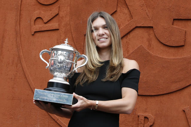Romania's Simona Halep poses with the cup at the Roland Garros stadium, Sunday, June 10, 2018 in Paris. Halep won Saturday the French Open tennis tournament women's final. (AP Photo/Thibault Camus)