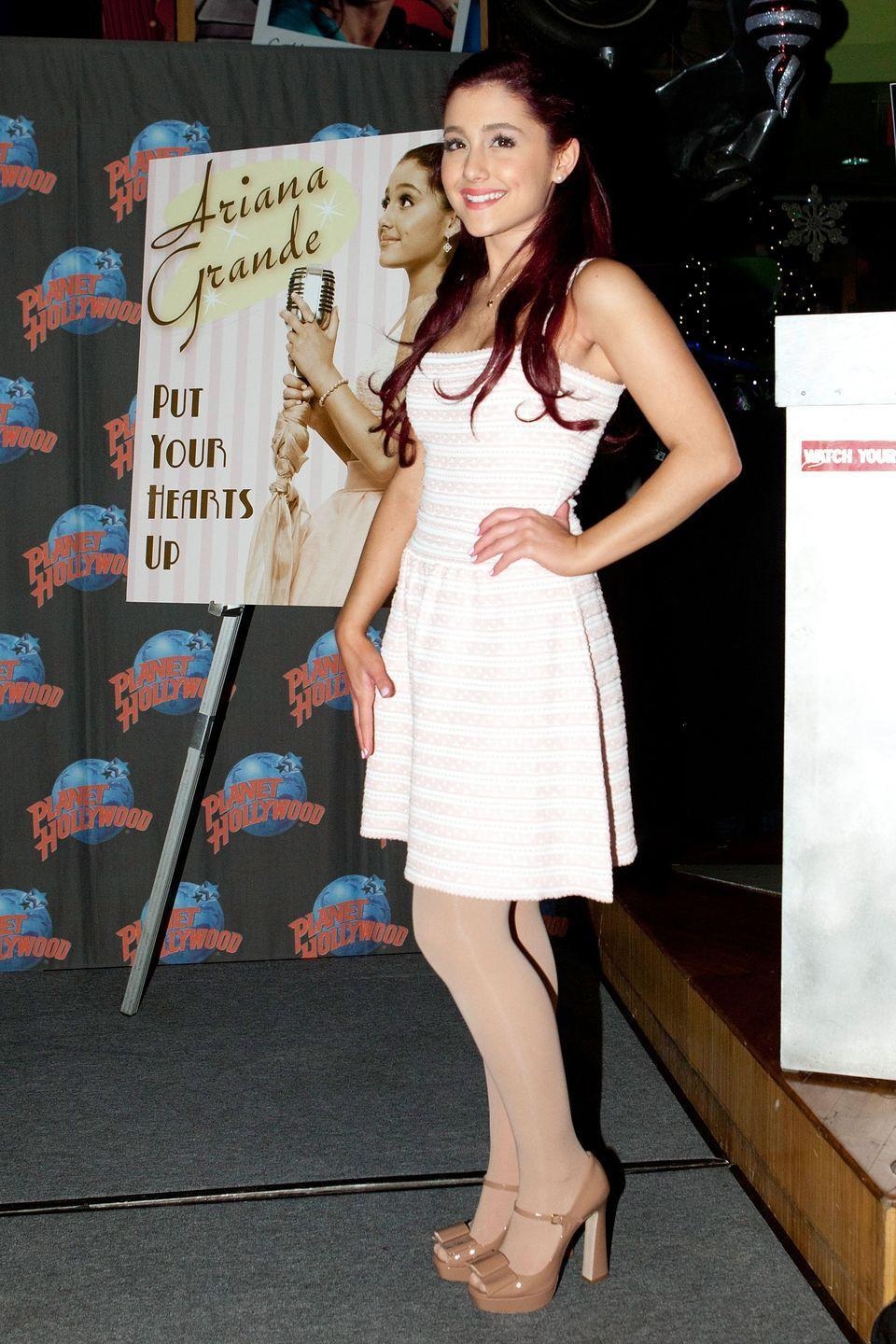 <p>Ariana Grande at Planet Hollywood in Time's Square.</p>