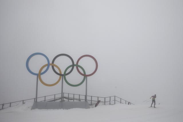 An athlete trains in heavy fog at the cross-country stadium in Krasnaya Polyana, Russia, during the 2014 Winter Olympics, Monday, Feb. 17, 2014. Thick fog rolled in over the mountains in Krasnaya Polyana on Sunday night and was still lingering on Monday, limiting visibility and delaying both a biathlon and snowboard event. (AP Photo/Jae C. Hong)