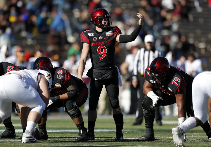 San Diego State quarterback Ryan Agnew (9) signals before the snap during the first half of the New Mexico Bowl NCAA college football game against Central Michigan on Saturday, Dec. 21, 2019 in Albuquerque, N.M. (AP Photo/Andres Leighton)