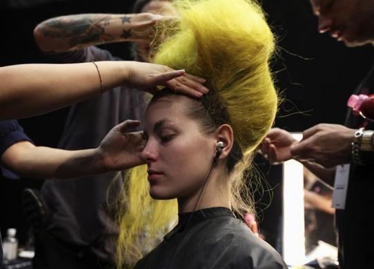 A wig is put on a model backstage at the Meadham Kirchoff Autumn/Winter show during London Fashion Week in London, February 21, 2012.