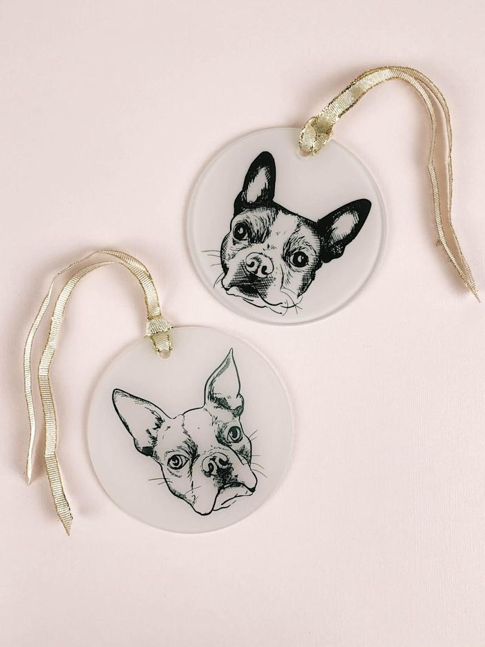"""The new pet parent who can never stop talking about their furry friend can take their obsession to the tree with these personalized ornaments from Etsy. If you're the pet mom in question, there's no shame in snagging one for yourself, but it'd be a most-loved gift for the dog whisperer on your list. $25, Etsy. <a href=""""https://www.etsy.com/listing/737553026/pet-portrait-ornament-round-holiday"""" rel=""""nofollow noopener"""" target=""""_blank"""" data-ylk=""""slk:Get it now!"""" class=""""link rapid-noclick-resp"""">Get it now!</a>"""