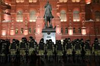 Law enforcement officers stand guard in front of a monument to Soviet Marshal Georgy Zhukov outside Red Square in Moscow following the jailing of Kremlin critic Alexei Navalny
