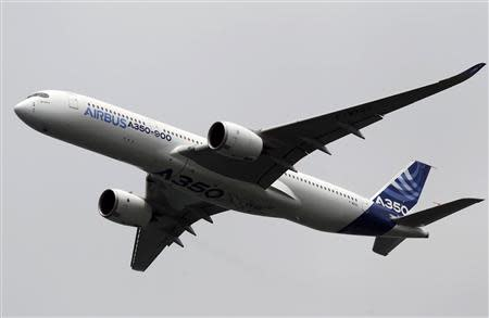 An Airbus A350 flies during an aerial display at the Singapore Airshow
