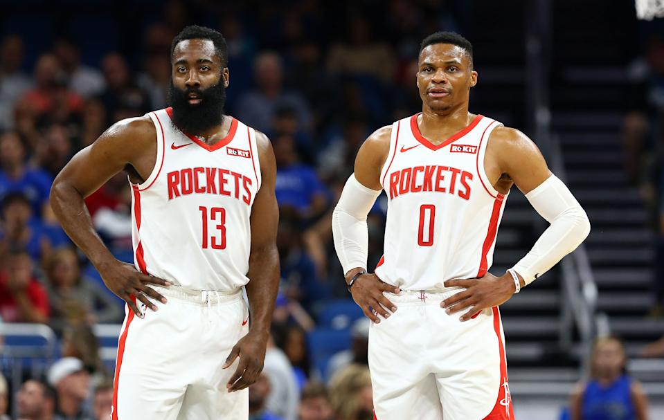 Dec 13, 2019; Orlando, FL, USA; Houston Rockets guard Russell Westbrook (0)  and Houston Rockets guard James Harden (13) look on against the Orlando Magic during the first quarter at Amway Center. Mandatory Credit: Kim Klement-USA TODAY Sports
