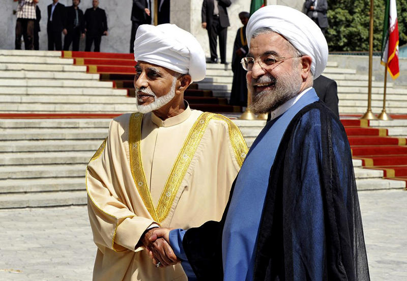 FILE - In this Aug. 25, 2013, file photo, released by the official website of the Iranian Presidency office, President Hasan Rouhani, right, shakes hands with Omani Sultan Qaboos during an official arrival ceremony, in Tehran, Iran. The U.S. and Iran secretly engaged in high-level, face-to-face talks, at least three times over the past year, in a high stakes diplomatic gamble by the administration that paved the way for the historic deal aimed at slowing Iran's nuclear program. Qaboos was a key player in facilitating the release of three American hikers who were detained when they strayed across the Iraq boarder into Iran. Qaboos then offered himself as a mediator for a U.S.-Iran rapprochement, starting the secret informal discussion between Washington and Tehran. (AP Photo/Iranian Presidency Office, Hojjat Sepahvand)