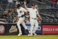 New York Yankees' Phil Nevin, right, celebrates with New York Yankees' Joey Gallo as he runs the bases after hitting a home run during the sixth inning of a baseball game against the Texas Rangers Tuesday, Sept. 21, 2021, in New York. (AP Photo/Frank Franklin II)