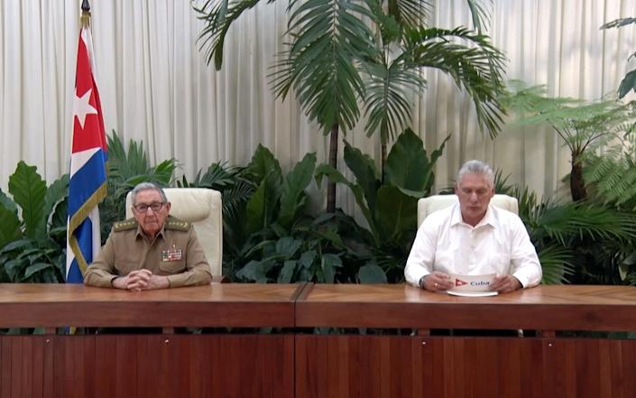 President Miguel Diaz-Canel, right, announced the plans beside Raul Castro, the Communist Party leader - EPA