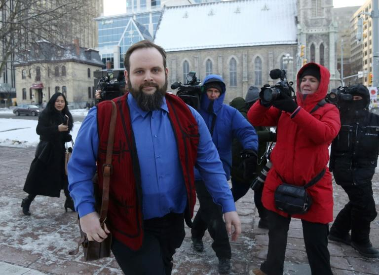 Former Afghan hostage Joshua Boyle leaves the Ottawa courthouse after charges he abused his wife and another person are dismissed (AFP Photo/Dave Chan)