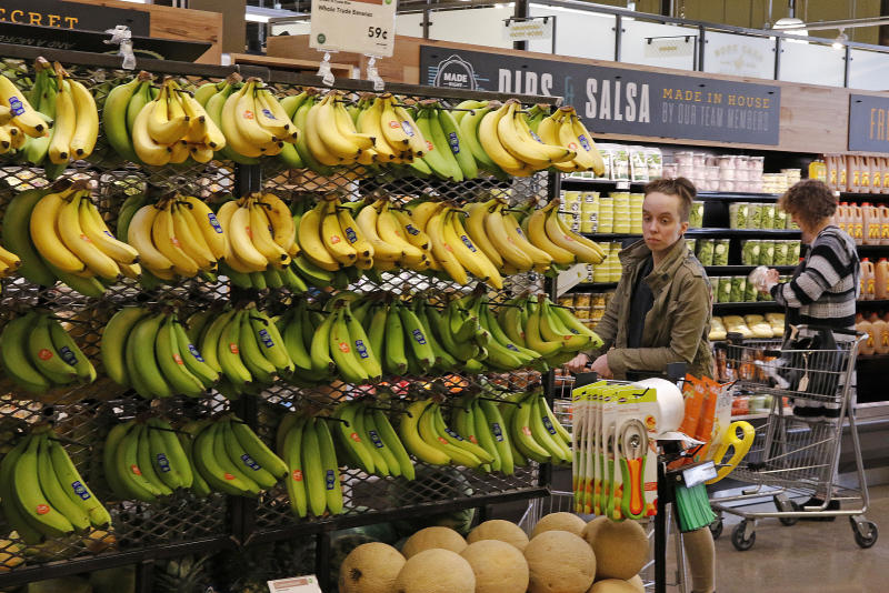 In this May 3, 2017, photo, customers shop at a Whole Foods Market in Upper Saint Clair, Pa. Amazon's planned $13.7 billion acquisition of Whole Foods signals a massive bet that people will opt more for the convenience of online orders and delivery or in-store pickup, putting even more pressure on the already highly competitive industry. (AP Photo/Gene J. Puskar)