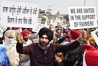 AMRITSAR, INDIA - SEPTEMBER 23: Congress leader Navjot Singh Sidhu along with his supporters march during a protest rally against the farm bills from Bhandari bridge to Hall gate on September 23, 2020 in Amritsar, India. (Photo by Sameer Sehgal/Hindustan Times via Getty Images)