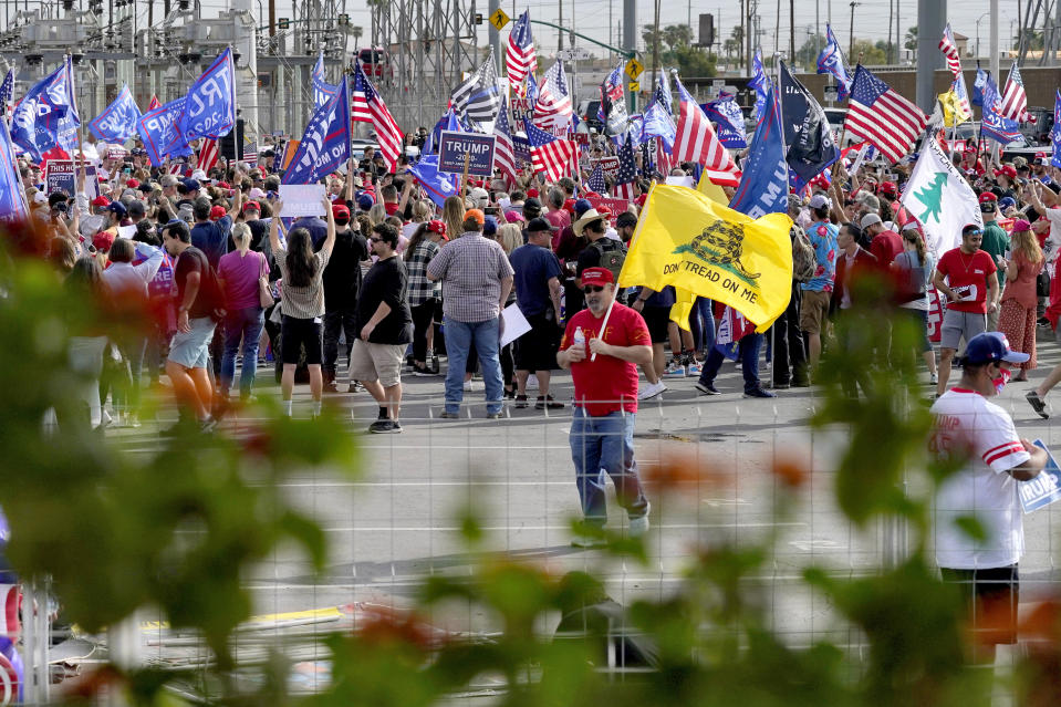 Crowds gather during a pro Trump rally outside the Maricopa County Recorder's Office where elections officials continue to count ballots for the general election, Friday, Nov. 6, 2020, in Phoenix. (AP Photo/Matt York)