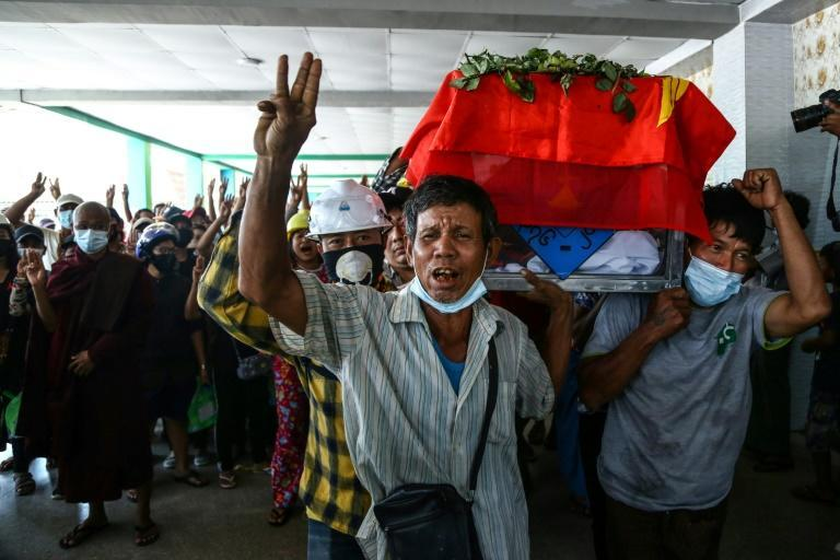 Mourners and protesters are holding up a three-finger salute to protest the junta