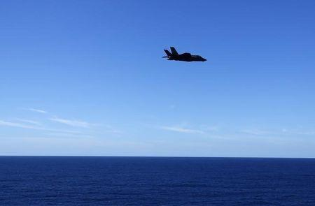 A Lockheed Martin Corp's F-35C Joint Strike Fighter is shown before landing on the deck of the USS Nimitz aircraft carrier, while off the coast of California