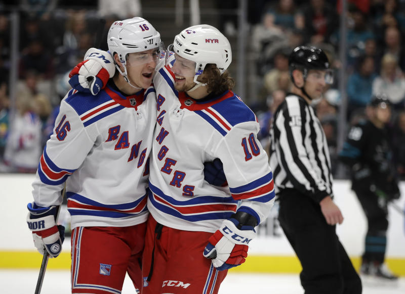 New York Rangers' Artemi Panarin, right, celebrates with Ryan Strome (16) after scoring against the San Jose Sharks in the second period of an NHL hockey game Thursday, Dec. 12, 2019, in San Jose, Calif. (AP Photo/Ben Margot)