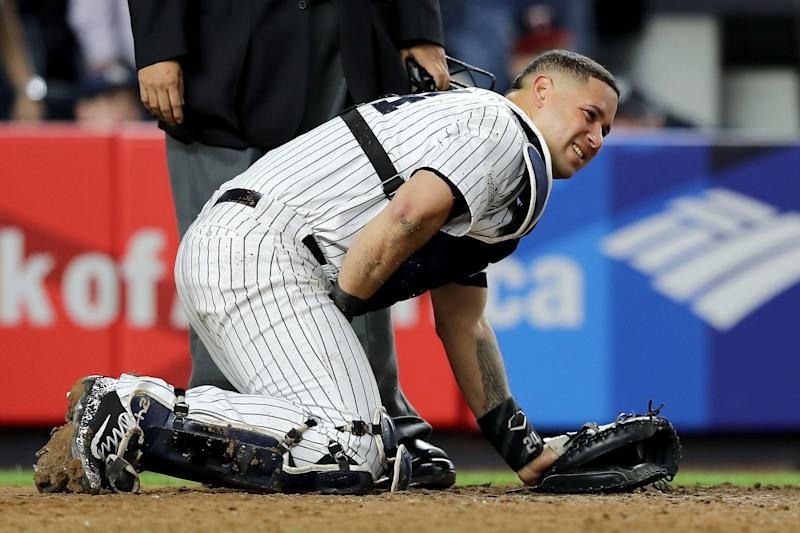 New York Yankees catcher Gary Sanchezdoubles over in pain after taking a foul ball to his privates during a game against the Minnesota Twins on Tuesday night. (Elsa via Getty Images)