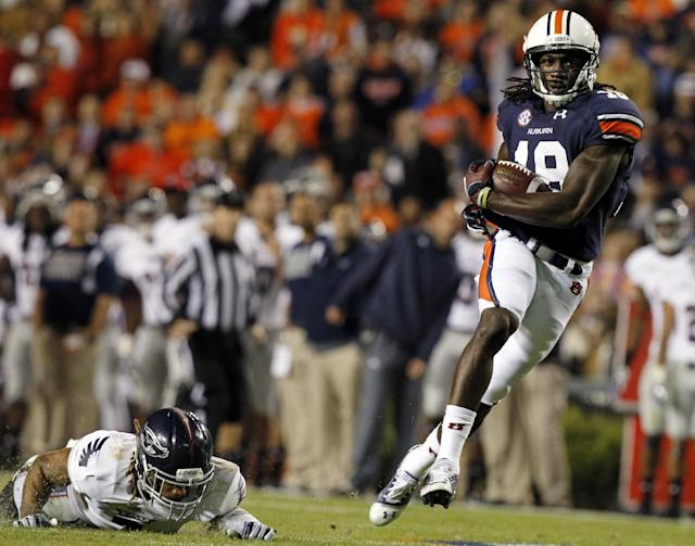 Auburn wide receiver Sammie Coates, right, catches a pass over Florida Atlantic defensive back Cre'von LeBlanc for a touchdown during the first half of an NCAA college football game Saturday, Oct. 26, 2013, in Auburn, Ala. (AP Photo/Butch Dill)