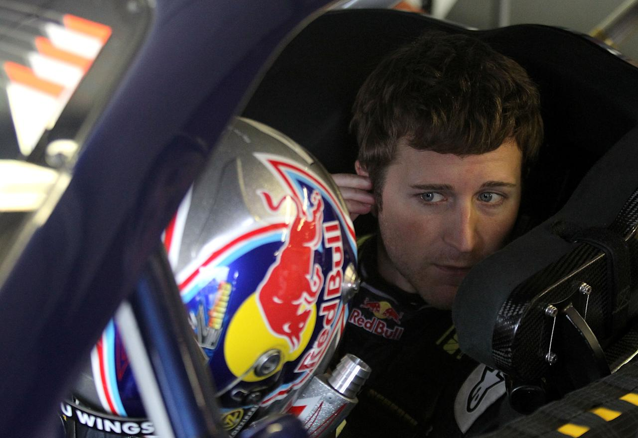 LOUDON, NH - SEPTEMBER 24:  Kasey Kahne, driver of the #4 Red Bull Toyota, adjusts his ear piece as he sits in his car during practice for the NASCAR Sprint Cup Series Sylvania 300 at New Hampshire Motor Speedway on September 24, 2011 in Loudon, New Hampshire.  (Photo by Tom Whitmore/Getty Images for NASCAR)