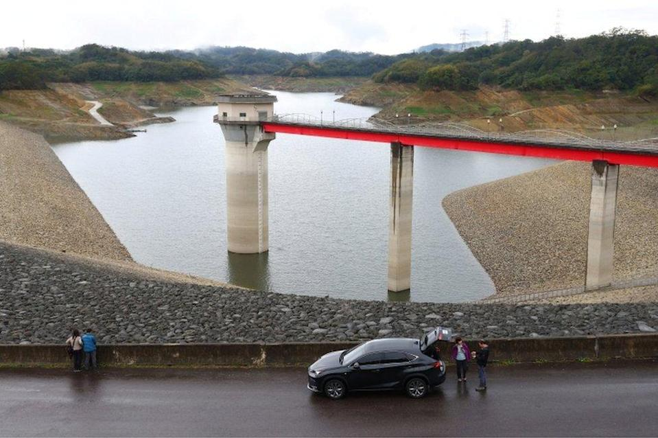 Tourists visit the Baoshan second reservoir amid low water levels during an island-wide drought, in Hsinchu, Taiwan, on March 6, 2021.