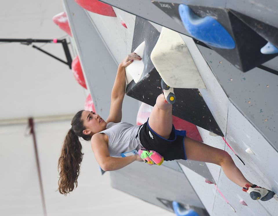 """<p><strong>Sport:</strong> Sport Climbing<br> <strong>Country:</strong> USA</p> <p>In August 2019, Brooke Raboutou became <a href=""""https://www.popsugar.com/fitness/Who-Is-Brooke-Raboutou-46513160"""" class=""""link rapid-noclick-resp"""" rel=""""nofollow noopener"""" target=""""_blank"""" data-ylk=""""slk:the first American to qualify for the Olympics in sport climbing"""">the first American to qualify for the Olympics in sport climbing</a>, a sport that combines three disciplines of rock climbing: lead climbing, speed climbing, and bouldering. Raboutou already has several world titles under her belt and comes from a family of climbers (her mom won <a href=""""https://www.climbing.com/people/robyn-erbesfield-raboutou-the-veteran-coach-leading-the-new-generation-of-climbers/"""" class=""""link rapid-noclick-resp"""" rel=""""nofollow noopener"""" target=""""_blank"""" data-ylk=""""slk:four consecutive World Cup titles"""">four consecutive World Cup titles</a>), and she'll need all of that experience and grit to compete for Olympic gold. One of Brooke's primary goals at the Games, though: to <a href=""""https://www.teamusa.org/News/2019/October/02/QA-With-Brooke-Raboutou-The-First-American-Climber-To-Qualify-For-An-Olympic-Games"""" class=""""link rapid-noclick-resp"""" rel=""""nofollow noopener"""" target=""""_blank"""" data-ylk=""""slk:grow her sport"""">grow her sport</a> in front of a global audience.</p>"""