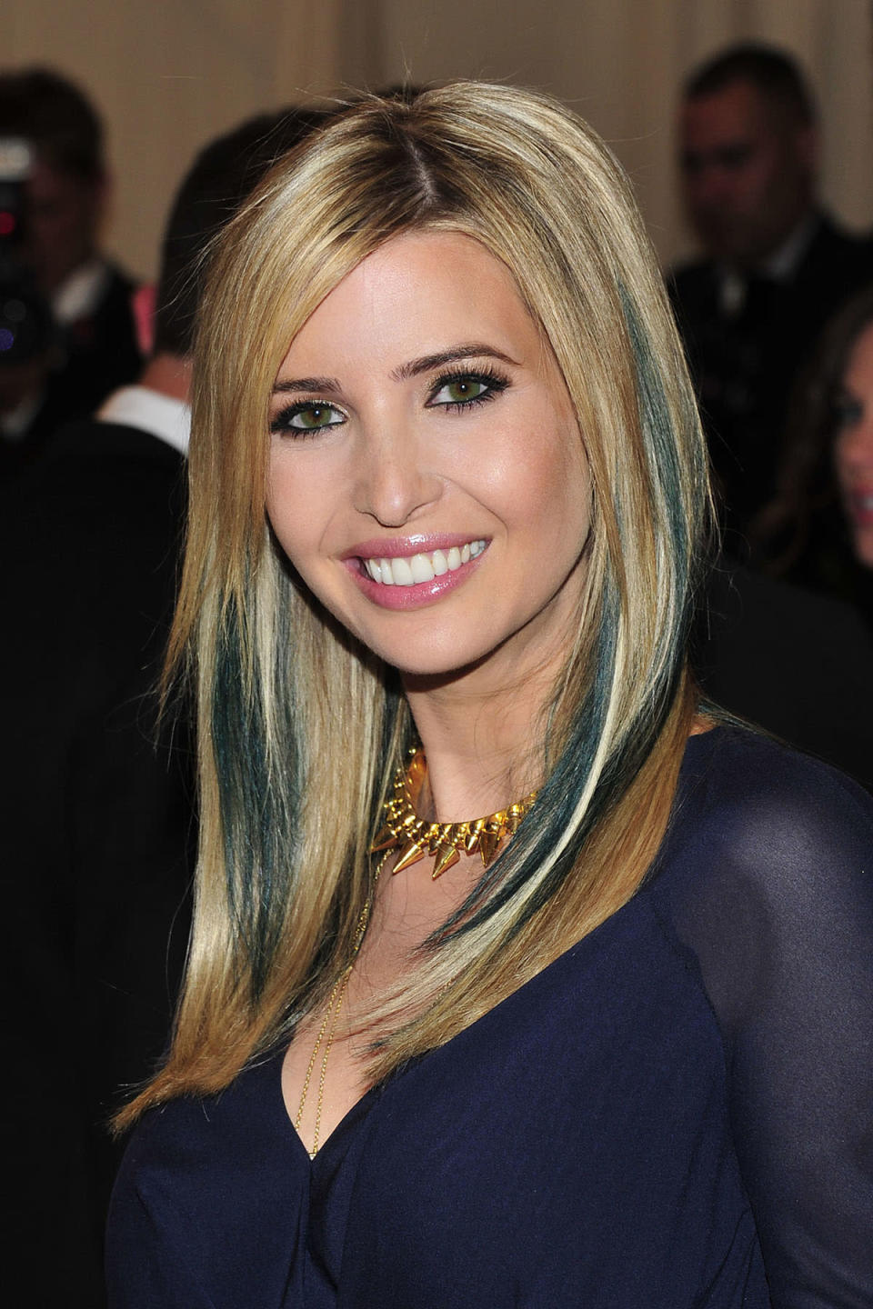 <p>Ivanka brings back the contacts and tries out striking teal hair extensions for the Met Gala. (Photo: AP Images) </p>