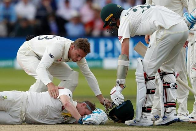 Smith was sent tumbling to the floor by a vicious bouncer (AFP Photo/Adrian DENNIS)