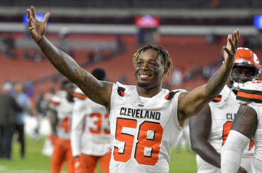 Cleveland Browns linebacker Christian Kirksey celebrates after the Browns defeated the Philadelphia Eagles 5-0 in an NFL preseason football game Thursday, Aug. 23, 2018, in Cleveland. (AP Photo/David Richard)