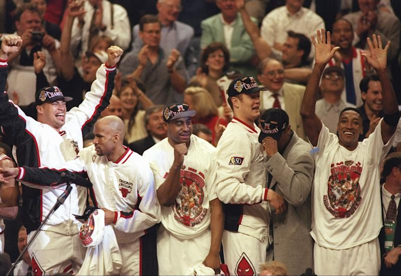 13 Jun 1997: (l-r) Brian Williams, Ron Harper, Jason Caffey, Luc Longley and Scottie Pippen of the Chicago Bulls celebrate after winning game 6 of the 1997 NBA Finals at the United Center in Chicago, Illinois. The Bulls defeated the Jazz 90-86 to win the series and claim the championship.